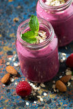 Berry smoothie in a bottle on a dark background, top view. Vertical Royalty Free Stock Image