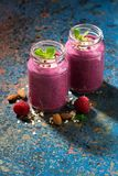 Berry smoothie in a bottle and dark background, vertical. Top view Stock Photo