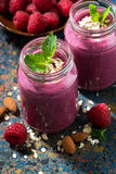 Berry smoothie in a bottle on a dark background, vertical. Top view, closeup Stock Image
