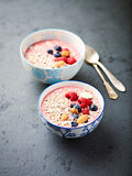 Berry smoothie bowl with buckwheat flakes and almonds Royalty Free Stock Photo