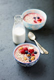 Berry smoothie bowl with buckwheat flakes and almonds Stock Images