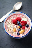 Berry smoothie bowl with buckwheat flakes and almonds Royalty Free Stock Photography
