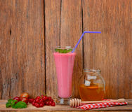 Berry smoothie, currants, gooseberries and honey Royalty Free Stock Photo