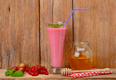 Berry smoothie, currants, gooseberries and honey Royalty Free Stock Image
