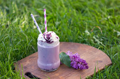 Berry smoothie decorated with whipped cream. Stock Photo