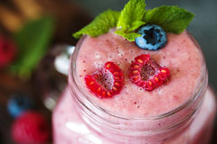 Berry smoothie with fresh raspberry and blueberry. Well being and weight loss concept, berry smoothie with fresh raspberry and blueberry Stock Photos