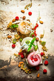 Berry smoothie made from currants, gooseberries and raspberries with nuts. Royalty Free Stock Photo