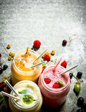 Berry smoothie made from raspberries, currants and gooseberries. On a stone background Stock Photo