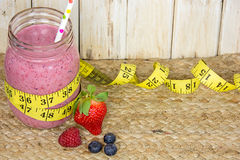 Berry smoothie with measuring tape Stock Photo