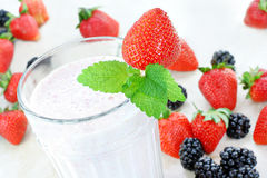 Berry smoothie or milkshake top view. Royalty Free Stock Image