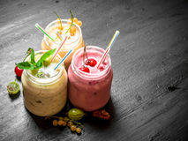 Berry smoothie with mint and nuts. On the black chalkboard Royalty Free Stock Photo