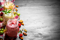 Berry smoothie with mint and nuts. On the black chalkboard Royalty Free Stock Image