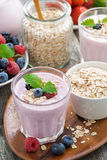 Berry smoothie with oatmeal in a glass, vertical Stock Image
