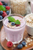 berry smoothie with oatmeal in a glass, vertical, top view Stock Images