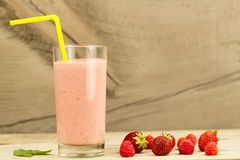 Berry smoothie with raspberries and strawberries on wooden background. Fresh berry smoothie with raspberries and strawberries on wooden background Stock Images