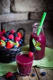 Berry smoothie on rustic wooden background Royalty Free Stock Photo