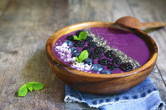 Berry smoothie in a wooden bowl.Top view. Stock Photos