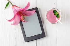 Berry smoothie with yogurt and ebook. Top view stock photo