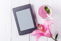Berry smoothie with yogurt and ebook royalty free stock image