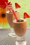 Berry Smoothies. Fruit smoothies with strawberry and blueberries in glasses Royalty Free Stock Photos