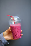 Berry Smoothies. Disposable cup in woman hand closeup Stock Photography