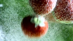 Berry, strawberries in water with bubbles, hand stock video footage