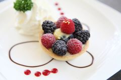 Berry tart cake. On a plate stock images