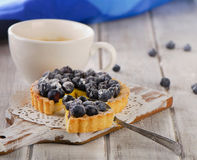 Berry tart and cup of coffee Royalty Free Stock Image