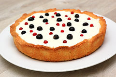 Berry tart: shortbread dough, a layer of black currant curd, whi Royalty Free Stock Photos