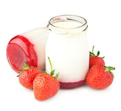 Berry yogurt. In a glass jar and fresh strawberries over white background stock image