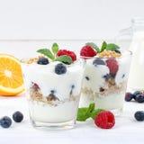 Berry yogurt yoghurt with berries fruits cup muesli square woode Stock Images