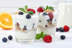 Berry yogurt yoghurt with berries fruits cup muesli wooden board royalty free stock images