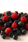 Berrymix. Fresh raspberrys and blueberrys in studio Royalty Free Stock Photography