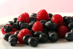 Berrymix. Fresh raspberrys and blueberrys in studio Stock Photo
