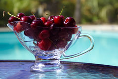 Berrys by the swimmimg pool. Cherry on the table by the swimming pool Royalty Free Stock Photo