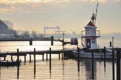 Berth for boats against port. In the winter afternoon in Kiel in Germany Royalty Free Stock Photography