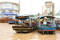 Berth with boats on Mekong River Stock Photo