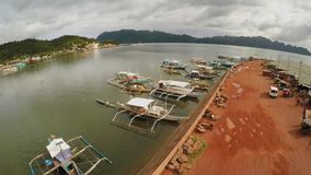 Berth with boats in the town of Coron. Palawan. Philippines. stock footage