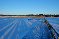 Berth in snow. Winter lake Stock Photo