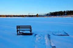 Berth in snow. Winter lake Stock Images