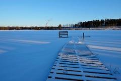 Berth in snow. Winter lake Stock Image