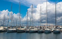 Berth with yachts under the clouds stock images