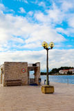Berth with street-lamp on sea Stock Images