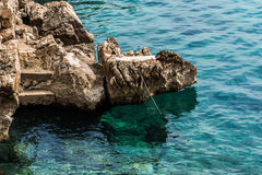 Berth on the turquoise clear sea. Baška, the island of Krk Stock Photo