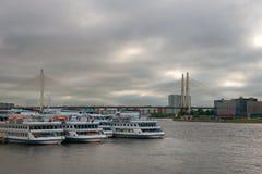 Berth Utkina Zavod. RUSSIA, SAINT PETERSBURG - AUGUST 18, 2017: Berth Utkina Zavod. White cruise ships moored to the pier Royalty Free Stock Image