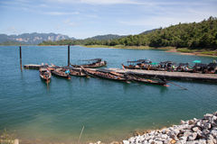 Berth wooden boats. Wooden boats are berthed at Cheow Lan Lake at The National Park Khao Sok royalty free stock photos