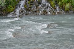 Bertha Creek in Turnagain Pass. Bertha Creek in the campground by flowing through the park. Fun way to spend some time in the Alaska summer stock photography