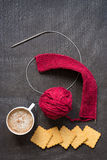 Bertical image of knitting, coffee and crackers Stock Image