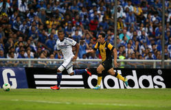 Bertrand. SHAH ALAM - JULY 21: Chelsea Football Club player Ryan Bertrand (white) dribbles past Malaysian player Norsharul Talaha (yellow) in a friendly match Royalty Free Stock Photos