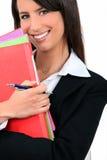 Berufsfrau mit Faltblättern Lizenzfreies Stockfoto